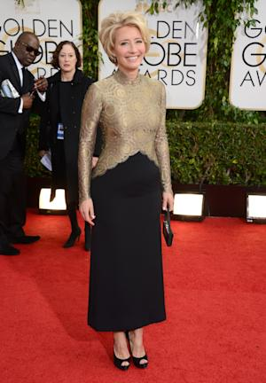 Emma Thompson arrives at the 71st annual Golden Globe Awards at the Beverly Hilton Hotel on Sunday, Jan. 12, 2014, in Beverly Hills, Calif. (Photo by Jordan Strauss/Invision/AP)