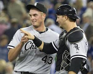 Chicago White Sox catcher A.J. Pierzynski congratulates pitcher Addison Reed on the save during their MLB American League baseball game in Toronto