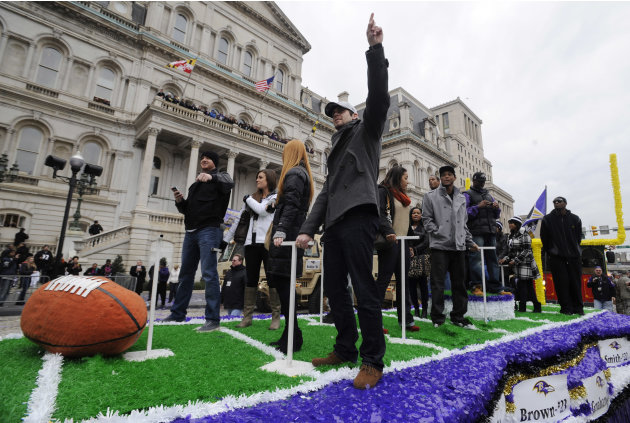 Baltimore Ravens rookie kicker Justin Tucker points to the sky at the start of  a victory parade outside of City Hall Tuesday, Feb. 5, 2013 in Baltimore. The Ravens defeated the San Francisco 49ers in