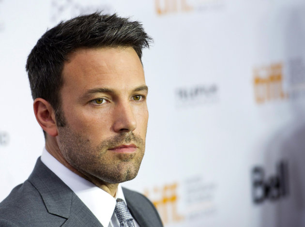 "FILE - This Sept. 7, 2012 file photo shows actor and director Ben Affleck poseing for a photograph on the red carpet at the gala for the new movie ""Argo"" during the 37th annual Toronto International Film Festival in Toronto. Affleck is comparing US Republican presidential candidate Mitt Romney to past presidential hopefuls Al Gore, Michael Dukakis and Bob Dole. But the actor and director, who has been outspoken in support of Democratic causes in the past, also doesn't offer full-throated support for President Barack Obama. (AP Photo/The Canadian Press, Nathan Denette)"