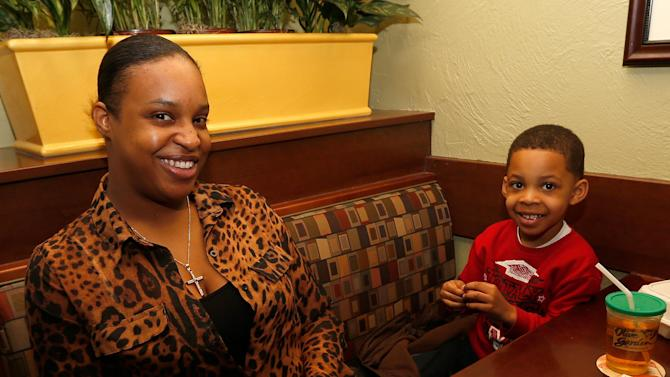 IMAGE DISTRIBUTED FOR OLIVE GARDEN - Montaez Marshall and his mother share lunch at Olive Garden in Naperville, Ill., on Take Our Daughters and Sons to Work Day. To celebrate the day, families can receive a free kid's meal with every adult entrée purchased on Thursday, April 25, 2013. (Scott Boehm/AP Images for Olive Garden)