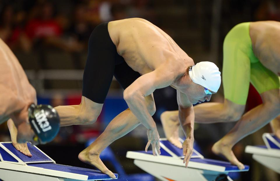 Peter Vanderkaay starts in the men's 200-meter freestyle preliminaries at the U.S. Olympic swimming trials, Tuesday, June 26, 2012, in Omaha, Neb. (AP Photo/Mark J. Terrill)
