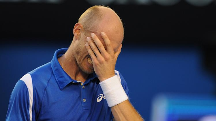 Russia's Nikolay Davydenko reacts during his second round loss to Switzerland's Roger Federer at the Australian Open tennis championship in Melbourne, Australia, Thursday, Jan. 17, 2013. (AP Photo/Andrew Brownbill)