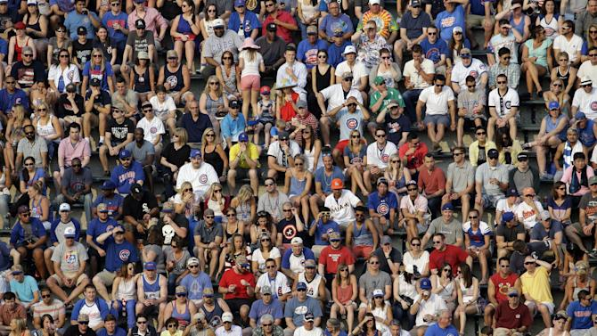Baseball fans watch a baseball game between the Miami Marlins and the Chicago Cubs Saturday, July 4, 2015, in Chicago. (AP Photo/Nam Y. Huh)