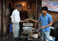 &lt;p&gt;Ram Singh (R) passes a glass of tea to a customer at a shop in old quarters of New Delhi. Singh, 17, earns just one dollar from the 100 cups of tea he makes every day outside Delhi railway station, but each evening, after packing up, he goes to the bank and deposits nearly half of it.&lt;/p&gt;