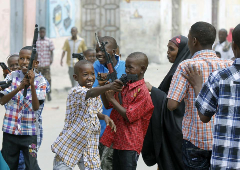 Somali children play with toys guns in Mogadishu, Somalia during Eid al Fitr celebrations to mark the end of the Holy Month of Ramadan, Sunday Aug, 19, 2012.(AP Photo/Farah Abdi Warsameh)