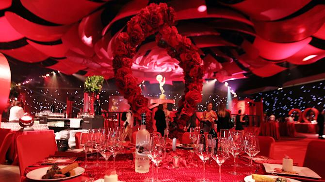 A table setting is seen inside the Emmy Awards Governors Ball preview at the Los Angeles Convention Center on Wednesday, Sept. 19, 2012, in Los Angeles. The Emmy Awards and the Governors Ball will be held Sunday, Sept 23. (Photo by Matt Sayles/Invision/AP)