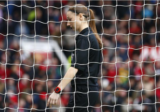 Assistant referee Massey checks the goalmouth during the English Premier League soccer match between Manchester United and Newcastle United at Old Trafford in Manchester
