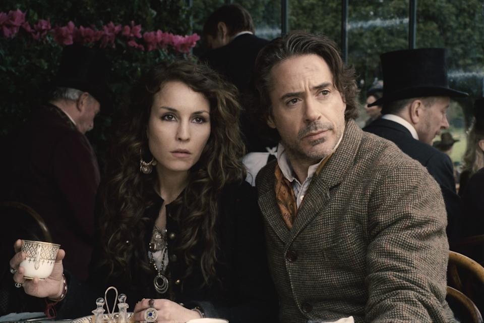 "In this film image released by Warner Bros. Pictures, Noomi Rapace, left, and Robert Downey Jr. are shown in a scene from ""Sherlock Holmes: A Game of Shadows."" (AP Photo/Warner Bros. Pictures)"