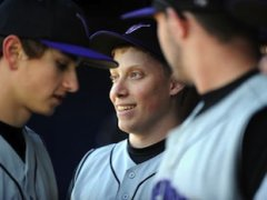 James Fuller smiles in the dugout — Chicago Sun-Times