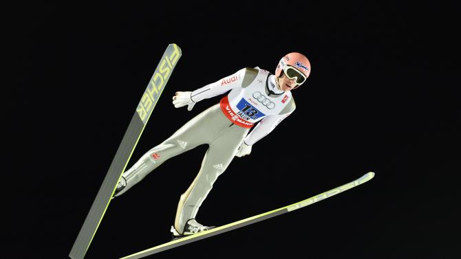 Germany's Severin Freund soars through the air during the men's large hill team ski jumping final at the FIS Nordic Skiing World Championships in Falun, Sweden, Saturday, Feb. 28, 2015. (AP Photo/Anders Wiklund, TT)    SWEDEN OUT