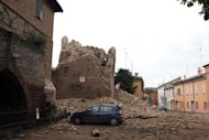 An old tower is seen completly destroyed after an earthquake shook downtown Finale Emilia, in the Modena province of Italy on May 20. In villages and towns across the flatlands of the Emilia Romagna region most of the modern two-storey homes remained intact while Art Nouveau villas, rustic farmhouses and churches were brought down by the 5.9-magnitude quake