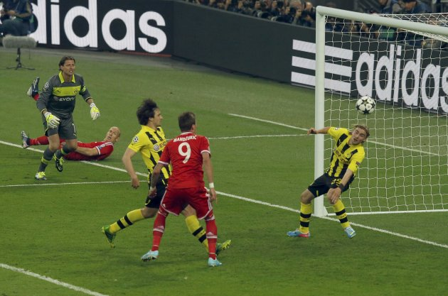 Bayern Munich's Mario Mandzukic shoots to score past Borussia Dortmund's Marcel Schmelzer during their Champions League Final soccer match at Wembley Stadium in London