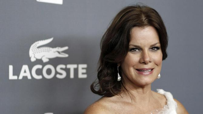 """FILE - In this Feb. 21, 2012 file photo, actress Marcia Gay Harden arrives at the 14th Annual Costume Designers Guild Awards at the The Beverly Hilton hotel in Beverly Hills, Calif. Since getting cast in the film adaptation of """"Fifty Shades of Grey,"""" Jamie Dornan, who plays the S&M loving, billionaire Christian Grey, has largely stayed out of the public eye. This aura of mystery surrounding Dornan is a good thing, according to Gay Harden, who plays his mother in the movie. (AP Photo/Matt Sayles, file)"""