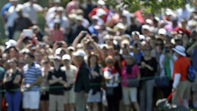 Tiger Woods hits a shot from the 18th fairway to the green during the final round of the Arnold Palmer Invitational golf tournament, Monday, March 25, 2013, in Orlando, Fla. (AP Photo/John Raoux)