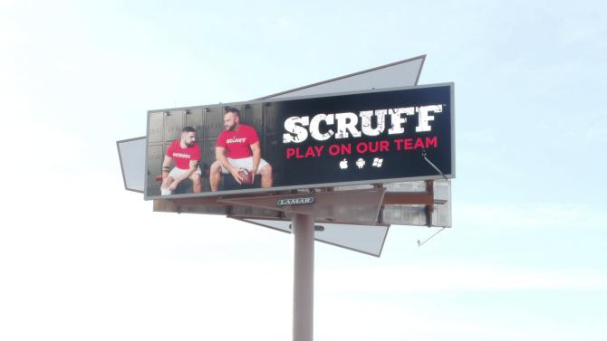 Handout photo of a billboard, part of a campaign by gay social networking application SCRUFF, which features two men looking at each other in a locker room