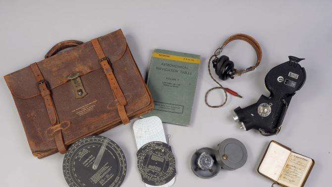 This undated photo provided by the Museum of World War II Boston shows items carried by Theodore J. Van Kirk, the navigator aboard the Enola Gay on the mission to Hiroshima. An original copy of the operations order for dropping an atomic bomb on Hiroshima is on display at the private museum in the Boston suburbs as the deadly attack marks its 70th anniversary. Museum of World War II founder Kenneth Rendell says the order provides a glimpse into what crew members experienced that fateful day. (Museum of World War II Boston via AP)
