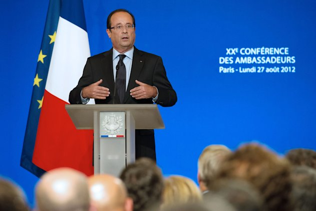 France's President Francois Hollande, gestures as he speaks to France's ambassadors at the Elysee Palace, Monday, Aug. 27, 2012. President Francois Hollande presented his foreign policy goals to France's ambassadors, with the Syrian crisis and terrorism in Africa's Sahel region on the agenda. (AP Photo/Bertrand Langlois, Pool)