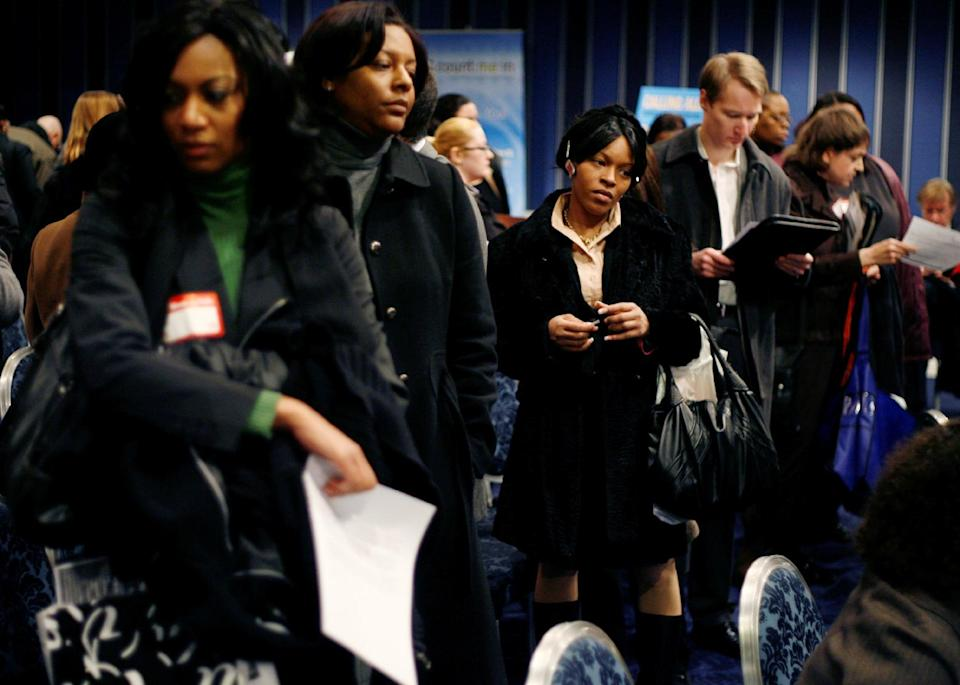 FILE - In this Tuesday, Feb. 24, 2009 file photo, people wait in line to talk to career counselors at a crowded job fair in New York. Thousands waited in line for two or more hours to enter the fair where about forty employers were talking to perspective hires. (AP Photo/Seth Wenig)