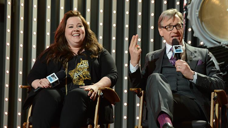 """Cast member of the  """"The Heat"""" actress Melissa McCarthy, left, and director Paul Feig are seen at """"The MTV Movie Awards Sneak Peek Week"""" on Thursday, April 11, 2013, in Universal City, Calif. (Photo by Jordan Strauss/Invision for MTV/AP Images)"""