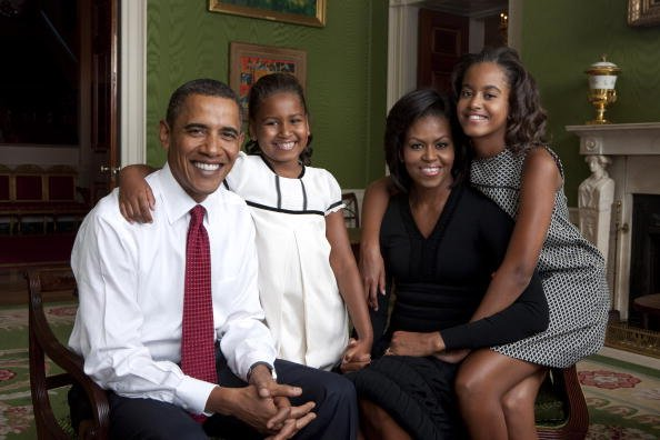 In this handout form the White House, (L to R) U.S. President Barack Obama, daughter Malia Obama, first lady Michelle Obama and daughter Sasha Obama sit for portrait in the Green Room of the White Hou