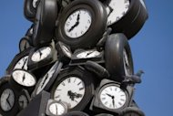 An installation of clocks by French artist Arman in Paris in March. Horologists around the world on Saturday will carry out one of the weirdest operations of their profession: they will hold back time