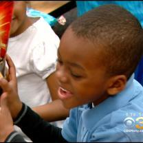 Santa Brings Presents To More Than 3,000 Students At Chester Community Charter School