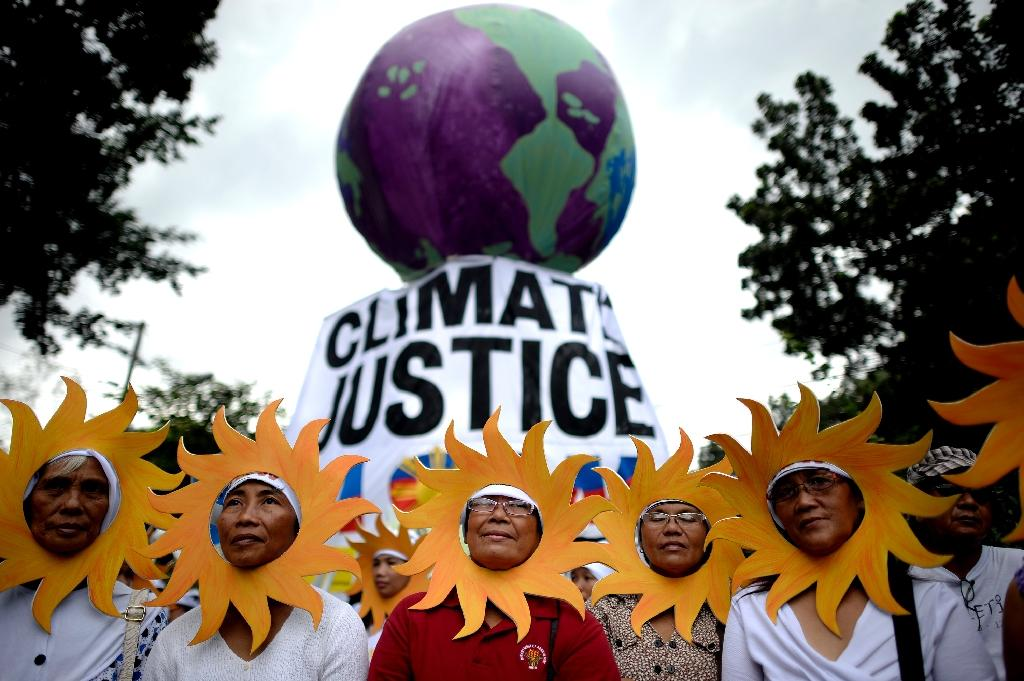 Thousands join climate change marches across Asia
