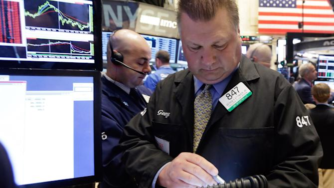 Traders George Ettinger works on the floor of the New York Stock Exchange Monday, April 20, 2015. U.S. stocks are opening higher as more big companies turn in healthy financial results for the first quarter of the year. (AP Photo/Richard Drew)