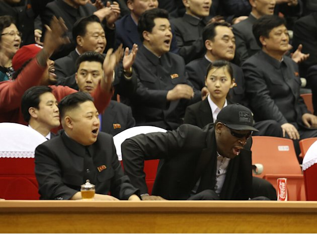 North Korean leader Kim Jong Un, left, and former NBA star Dennis Rodman watch North Korean and U.S. players in an exhibition basketball game at an arena in Pyongyang, North Korea, Thursday, Feb. 28,