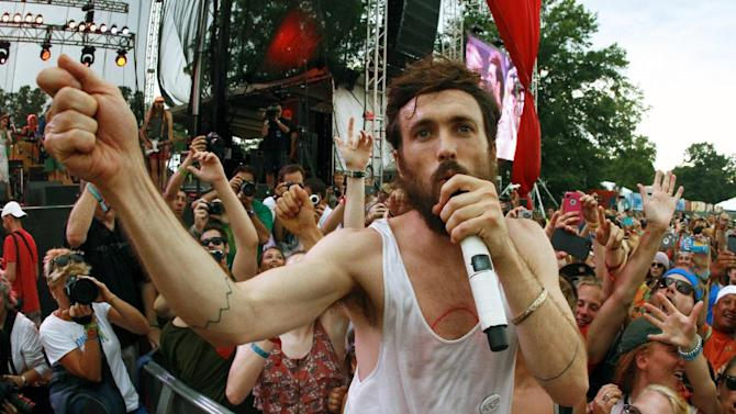 FILE - This June 16, 2013 file photo shows Alex Ebert of Edward Sharpe and the Magnetic Zeros performing on Day 4 of the 2013 Bonnaroo Music and Arts Festival in Manchester, Tenn. The band released its self-titled album on Tuesday, July 23. (Photo by Wade Payne/Invision/AP, File)