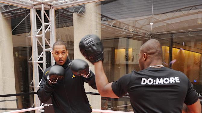IMAGE DISTRIBUTED FOR  DEGREE MEN - Carmelo Anthony, left, works out in a pop-up boxing ring at the Degree Men DO:MORE 'Afternoon Workout' event held atop the Madison Square Garden Marquee on Thursday, March 28, 2013 in New York.  Degree Men with MOTIONSENSE keeps Anthony protected because when he does more, Degree does too.  (Photo by Scott Gries/Invision for Degree Men/AP Images)