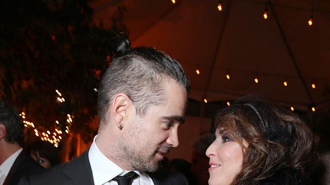 """Colin Farrell and Noomi Rapace at FilmDistrict's World Premiere of """"Dead Man Down"""" held at the ArcLight Hollywood, on Tuesday, Feb. 26, 2013 in Los Angeles. (Photo by Eric Charbonneau/Invision for FilmDistrict/AP Images)"""