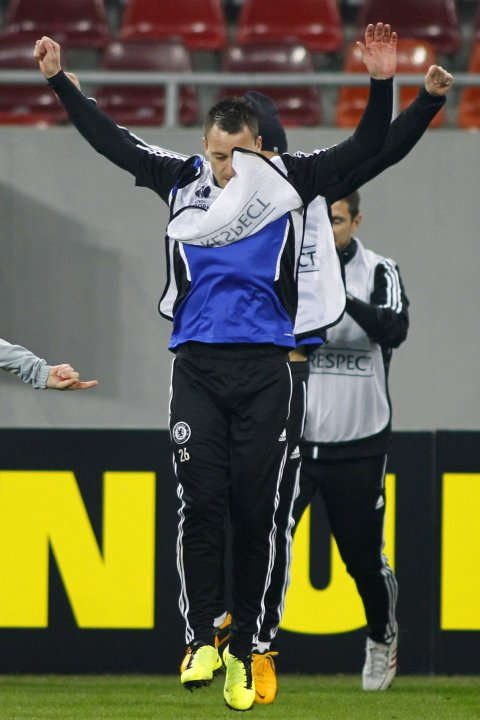 Chelsea's Terry attends a training session at National Arena in Bucharest
