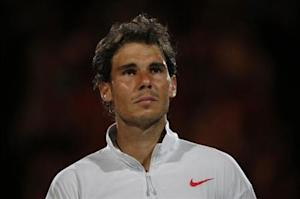 Rafael Nadal of Spain cries after being defeated in the men's singles final match against Stanislas Wawrinka of Switzerland at the Australian Open 2014 tennis tournament in Melbourne