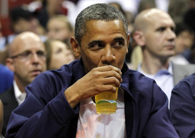 FILE - In this July 16, 2012 file photo, President Barack Obama sips his beer as he watches Team USA and Brazil during the first half of an Olympic men's exhibition basketball game, in Washington.