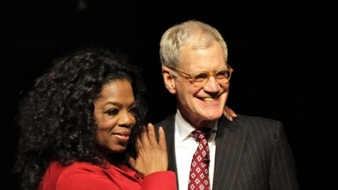 """FILE - This Nov. 26, 2012 file photo shows Ball State University alumnus David Letterman, right, host of CBS's """"Late Show,"""" with Oprah Winfrey following an interview at Ball State University in Muncie, Ind. Letterman says he sees a psychiatrist once a week, part of his attempt to be the person he once believed he was. The late-night talk show host gave an extraordinary interview to Oprah Winfrey, where he talked about his feuds with her and Jay Leno and his own effort to make amends for the affairs that became public three years ago when a man tried to extort him.  (AP Photo/Michael Conroy, file)"""