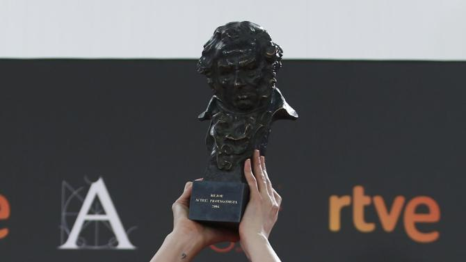 Actress de Molina, who won the Best Leading Actress award, raises up her trophy during the Spanish Film Academy's Goya Awards ceremony in Madrid