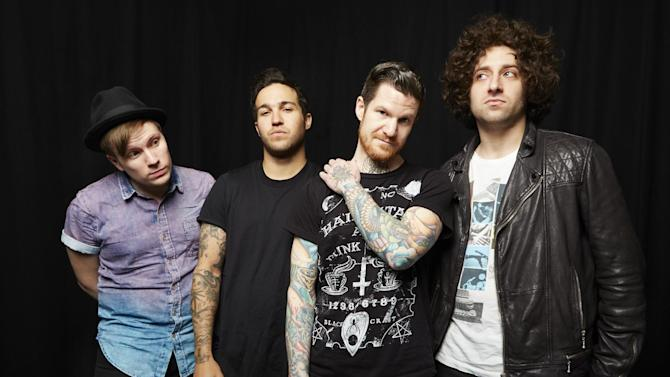 """This April 12, 2013 photo shows members of the band Fall Out Boy, from left, Patrick Stump, Pete Wentz, Andy Hurley and Joe Trohman in New York. Fall Out Boy's new album, """"Save Rock and Roll,"""" released April 16, features Elton John on the title track. (Photo by Dan Hallman/Invision/AP)"""
