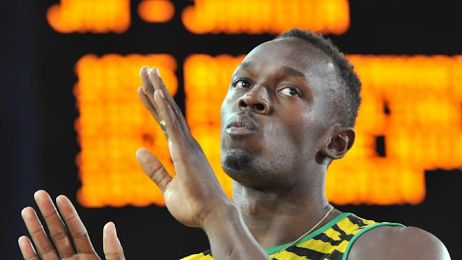 Jamaica's Usain Bolt waits for the start of the heats of the men's 4 x 100m relay athletics event at Hampden Park during the 2014 Commonwealth Games in Glasgow, Scotland on August 1, 2014