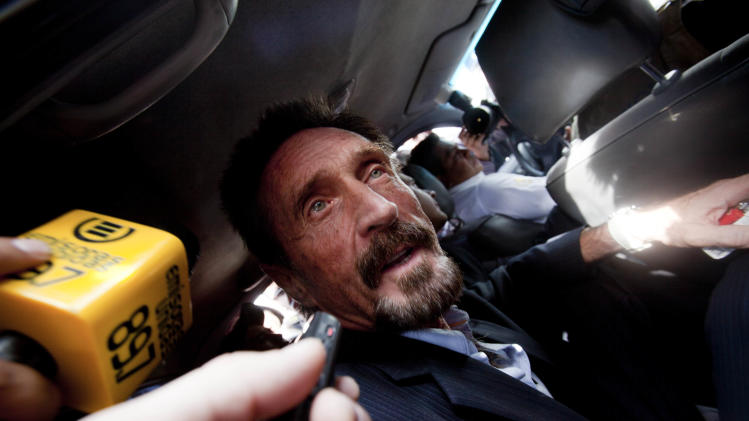 Software company founder John McAfee leaves an migration detention center for the La Aurora international airport in Guatemala City, Wednesday Dec. 12, 2012. McAfee was released from detention in Guatemala and is being deported to the U.S.  McAfee was detained last week for immigration violations after he sneaked into Guatemala from neighboring Belize, where authorities sought to question him about the murder of his neighbor. (AP Photo/Moises Castillo)