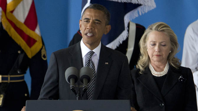 FILE - In this Sept. 14, 2012 file photo, President Barack Obama, accompanied by Secretary of State Hillary Rodham Clinton, speaks during a Transfer of Remains Ceremony at Andrews Air Force Base, Md., marking the return to the United States of the remains of the four Americans killed this week in Benghazi, Libya. Middle East violence is shaking up a U.S. presidential race that otherwise looks stubbornly stable _ and tight: President Barack Obama holds a tiny edge, Republican Mitt Romney seeks a break-through message, and three debates loom in the campaign's final seven weeks. Republicans and Democrats agree the election is likely to be decided on Obama's jobs-and-economy record, and both campaigns are entering a new campaign week working to shift the focus back to that issue. But foreign policy leaped to forefront of the campaign in recent days, as protestors attacked U.S. diplomats and missions in the Middle East. It's unclear when it will abate.  (AP Photo/Carolyn Kaster, File)