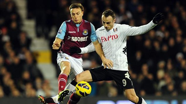 Fulham&#39;s Dimitar Berbatov (right) and West Ham United&#39;s Mark Noble (left) battle for the ball (PA Photos)