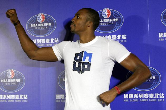 Houston Rockets Dwight Howard strikes a pss during an NBA basketball press conference in Taipei, Taiwan, Friday, Oct. 11, 2013. In a push for the NBA to expand its brand globally, Howard and the Rocke