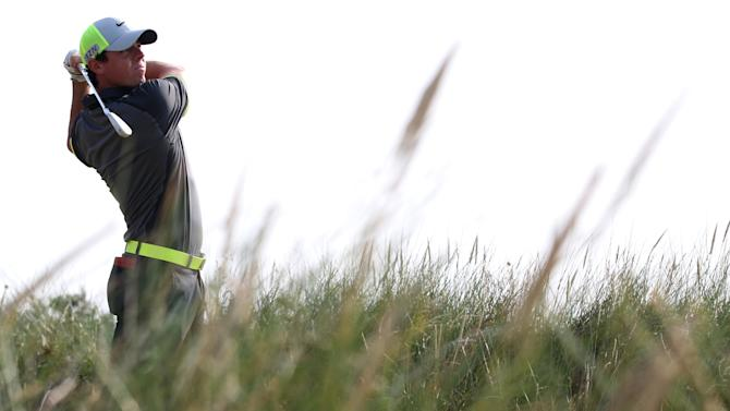 Northern Ireland's Rory McIlroy watches his shot from the 13th tee during his second round 66, on day two of the 2014 British Open at Royal Liverpool Golf Course in Hoylake on July 18, 2014