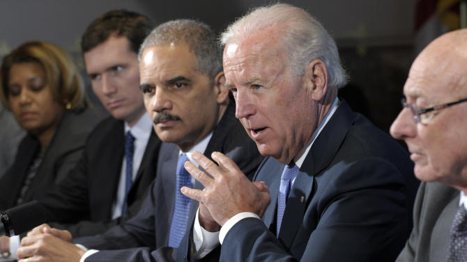 Vice President Joe Biden, with Attorney General Eric Holder at left, speaks during a meeting with victim's groups and gun safety organizations in the Eisenhower Executive Office Building on the White House complex in Washington, Wednesday, Jan. 9, 2013. Biden is holding a series of meetings this week as part of the effort he is leading to develop policy proposals in response to the Newtown, Conn., school shooting (AP Photo/Susan Walsh)