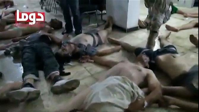 FILE - This Aug. 21, 2013 image from video that was released by a U.S. government official and shown to senators during a classified briefing on Thursday, Sept. 5, 2013, shows people of all ages apparently struggling with symptoms of nerve agent exposure and lying on the floor of a facility in Duma, Syria. The video was part of a DVD compilation of videos showing victims of the Aug. 21 chemical weapons attack near Damascus. Amid all the bloodshed, confusion and deadlock of Syria's civil war, one fact is emerging after 2½ years - no conflict ever has been covered this way. Amateur videographers - anyone with a smartphone, Internet access and an eagerness to get a message out to the world _ have driven the world's outlook on the war through YouTube, Twitter and other social media. (AP Photo via AP video, file)