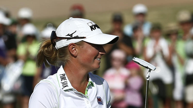 Stacy Lewis celebrates her win on the 18th green during the final round of the LPGA Founders Cup golf tournament on Sunday, March 17, 2013, in Phoenix. (AP Photo/Ross D. Franklin)
