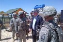 U.S. Senator John McCain is pictured with U.S. troops at a Patriot missile site in southern Turkey