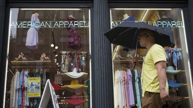 A man walks past an American Apparel store in New York
